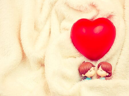 Closeup and vintage tone of sweet and sleeping couple dolls on fabric texture and red heart shape for valentines day, love, romance, wedding, relationship, honeymoon, family concept and idea. Imagens - 138898698