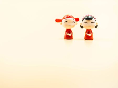 Chinese marriage couple dolls wear red ancient gown and groom clothing and gold colored background for wedding, love, valentines day concepts and ideas. Imagens - 139070746