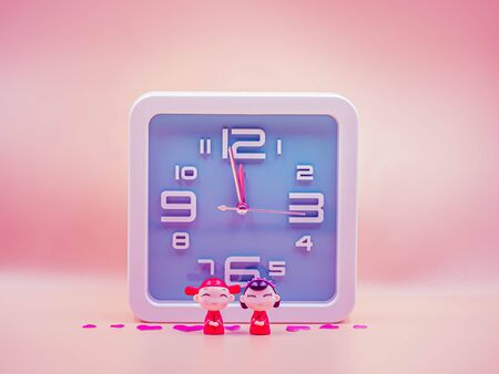 Pastel colored tone of square shape clock with cute chinese dolls wear ancient wedding dress and pink sticker on sweet pink gradient background for waiting or countdown time to wedding day concept.