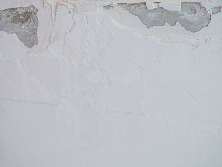Paint blistering and peeling problems on concrete or cement wall background.