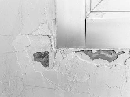 Abstract background and texture of cracked  and peeled paint cement or concrete wall with aluminuim window flame. Renovation concepts and ideas. Imagens