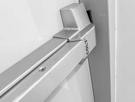 Black and white tone of unlock colt fire door. Security and safety concept and idea. Imagens
