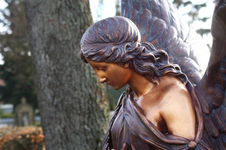 redemption: angel statue on Melaten graveyard in germany Stock Photo