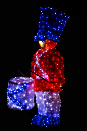 anthropomorphic: a drummer as a Christmas decoration in the night