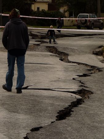earthquake: Christchurch, New Zealand, September 4 2010: Crack in road from Earthquake by Avon River