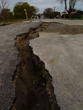 magnitude: Christchurch, New Zealand, September 4 2010: Crack in road from Earthquake by Avon River