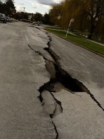 magnitude: Christchurch, New Zealand, September 4 2010: Crack through road from Earthquake by Avon River