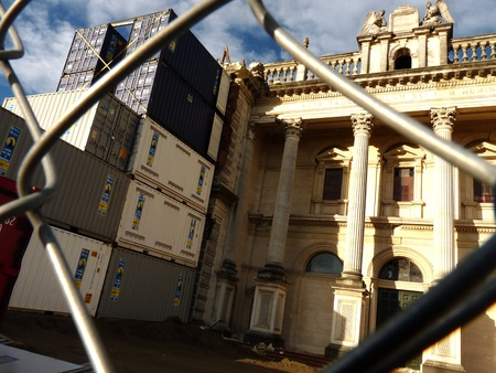 Shipping containers prop up damaged Cathedral of the Blessed Sacrament in Christchurch