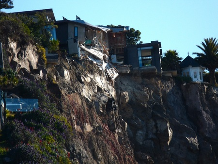 Damaged cliff-side homes in Redcliffs near Christchurch, New Zealand