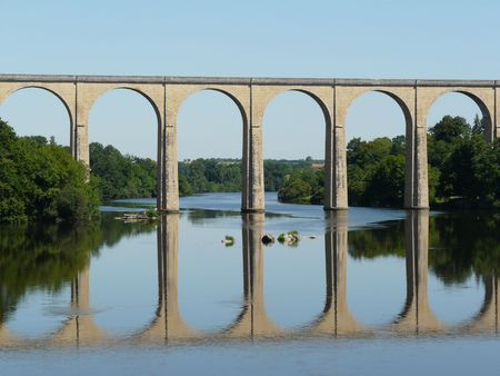 Old arched railway bridge over a river in France