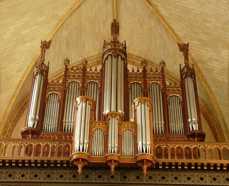 hymn: Large wooden organ with pipes in a church in France