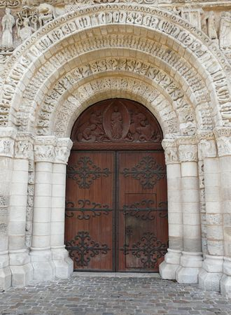 lintel: Wooden church door and stone lintel in Poitiers, France Stock Photo