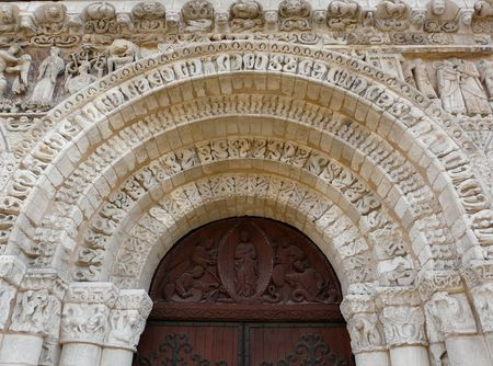 lintel: Carved stone and wood church lintel in Poitiers, France Stock Photo