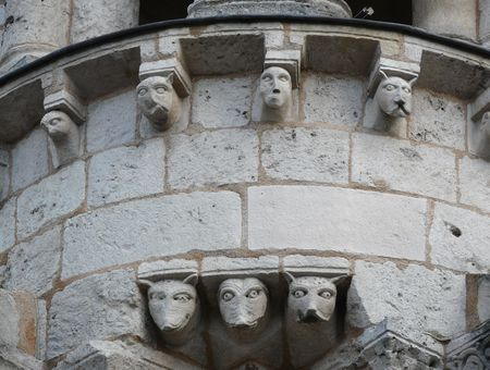 Gargoyles and stone carvings on Notre Dame church in Poitiers, France photo