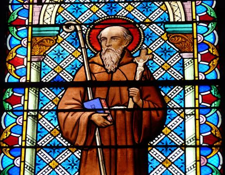Stained glass window of a Saint in a church in France
