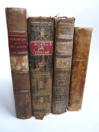 Old leather bound books with white background