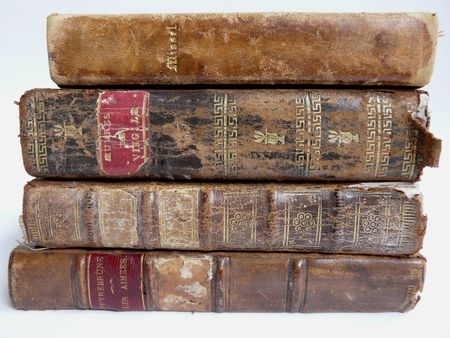 spines: Old leather bound books with white background