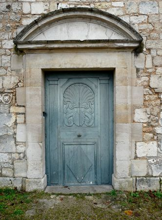 Arched entrance door to a church with carved detail Stock Photo - 4069136