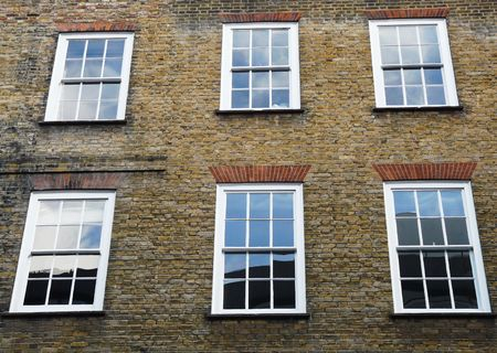 windows: Windows and brick exterior of a Georgian style property in London England Stock Photo