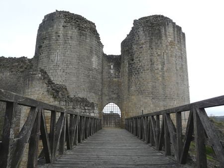 Castle tower ruins and entrance gate in Gencay France