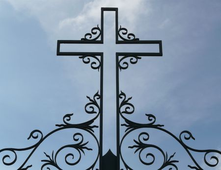 Silhouette of a metal cross against the sky Stock Photo