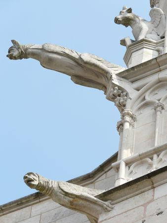 Gargoyles on a church in France Stock Photo