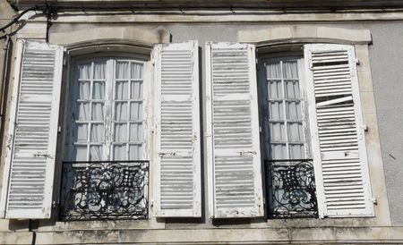 Classic windows and white shutters on a 19th century townhouse in Poitiers, France Stock Photo