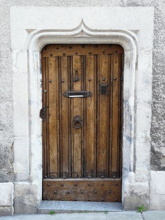 Old wooden door with medieval carved stone lintel in Poitiers, France Stock Photo - 4742414