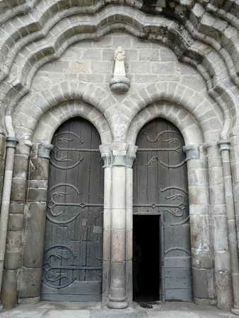 lintel: Arched medieval church doors with stone lintel in Le Dorat France
