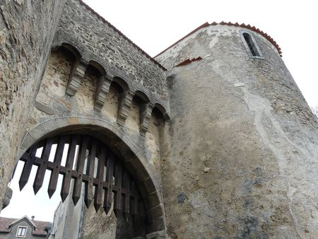 Castle entrance gate on the edge of the medieval town of Le Dorat in France Stock Photo