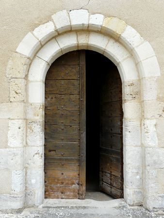 Arched medieval church door with stone lintel Stock Photo