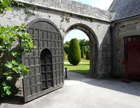 lanhydrock: Old wooden arched door at Lanhydrock Castle near Bodmin in Cornwall England