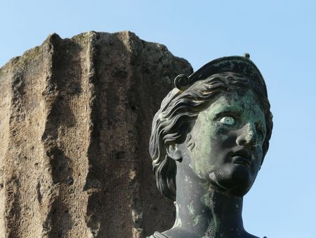 past civilizations: Statue of the goddess Diana and a column at the ancient Roman city of Pompeii, which was destroyed and buried by ash during the eruption of Mount Vesuvius in 79 AD Stock Photo