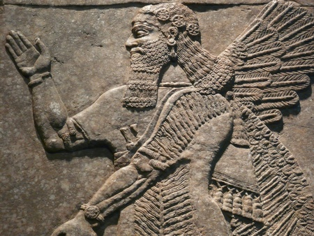 iraq: Ancient Assyrian wall carvings of a man