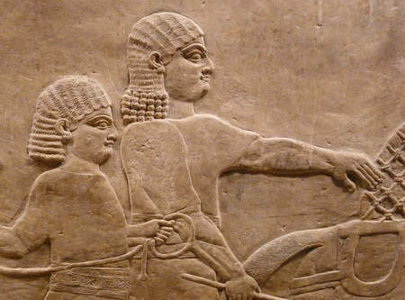 Ancient Assyrian wall carvings of men