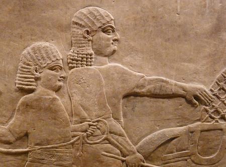 Ancient Assyrian wall carvings of men