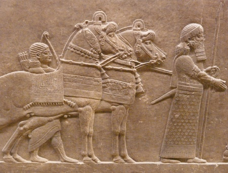 iran: Ancient Assyrian wall carvings of men and horses