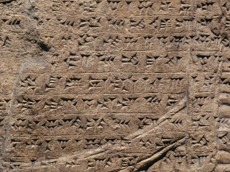 Ancient Assyrian wall carvings of cuneiform writing Stock Photo - 12341703
