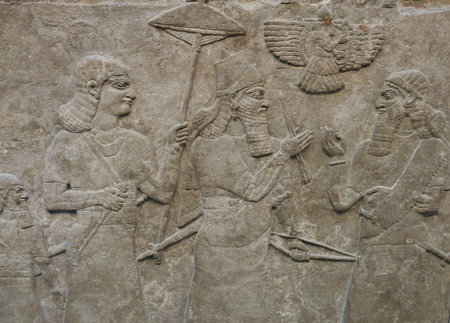Ancient Assyrian wall carving of men