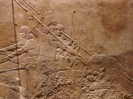 Ancient Assyrian wall carvings of men on a Royal lion hunt photo