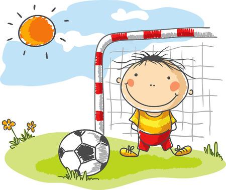 Little boy playing football as a goalkeeper