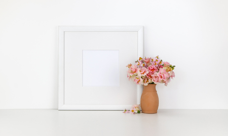 Square frame mockup on white background, flowers