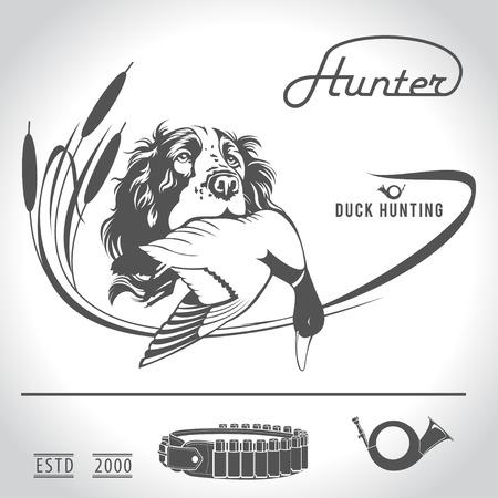 Hunting logo jachthond met een wilde eend in zijn tanden en design elementen. De outfit van de jager.