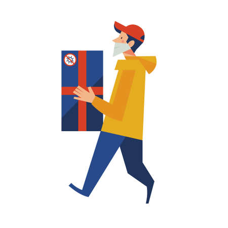 A courier in a medical mask delivers a box. Online purchases during the quarantine.