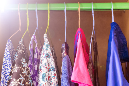 Womens clothes on hangers in the closet