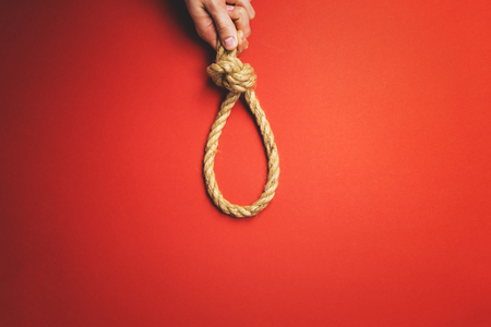 The man tightens the noose