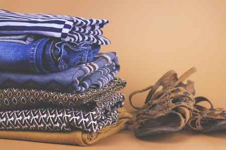 Womens shoes, clothing and accessories on a colored background Stock Photo