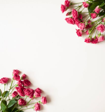 Mothers day. Womens day. Valentines day, Birthday background. Fresh roses. Spring flat lay, top view