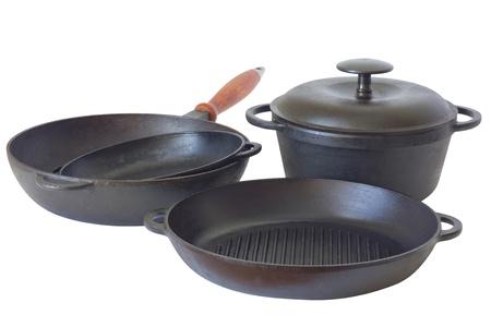 Set of cast iron pans. Isolated on white background.  photo