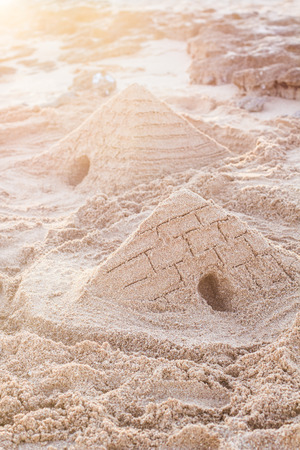 sandcastles: Egyptian pyramid of sand on the beach of Red sea